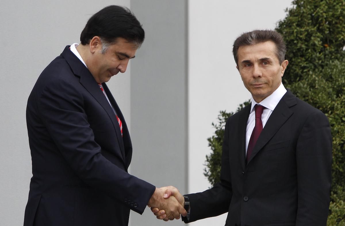 Georgian President Mikheil Saakashvili and head of the winning Georgian Dream party Bidzina Ivanishvili. October 2012. REUTERS/David Mdzinarishvili