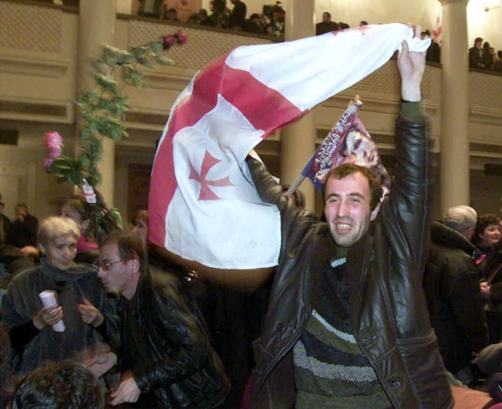 Saakashvili supporters in the session hall of parliament. 23 November 2003. REUTERS/David Mdzinarishvili