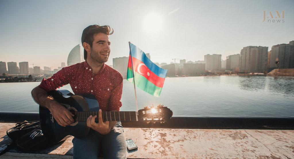 A boy playing guitar. Azerbaijani flag