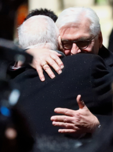 German President Frank-Walter Steinmeier and Israeli President Reuven Rivlin embrace as they return to Berlin together after the Auschwitz anniversary