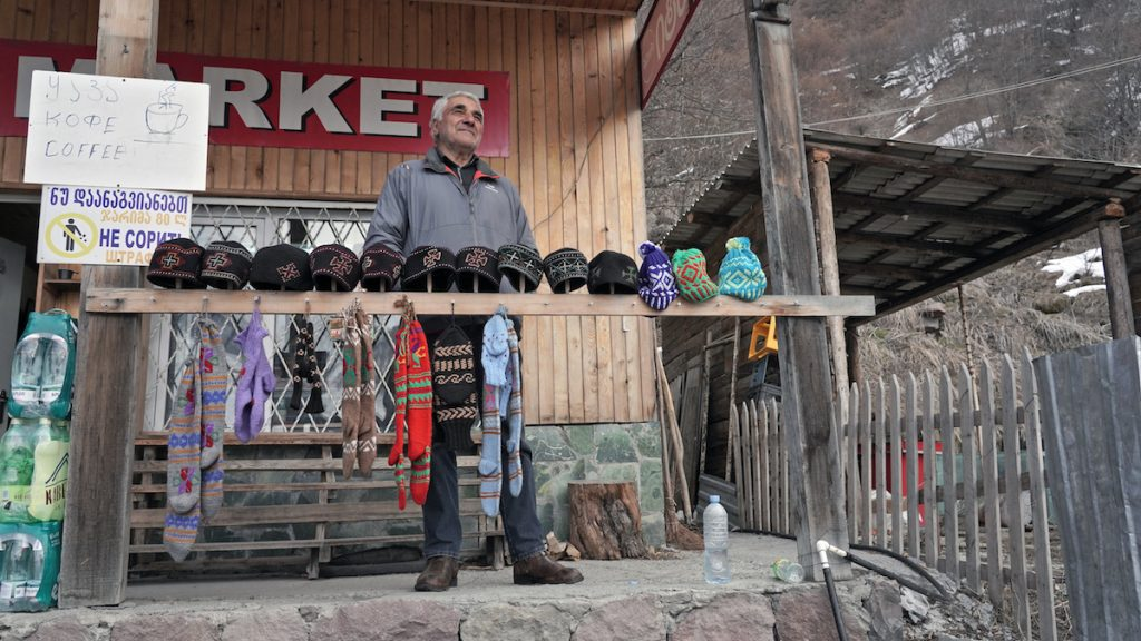 Entrepreneur Elguja Butkhuzi in front of his store on the Georgian Military Highway, March 2021. Photo: David Pipia, JAMnews