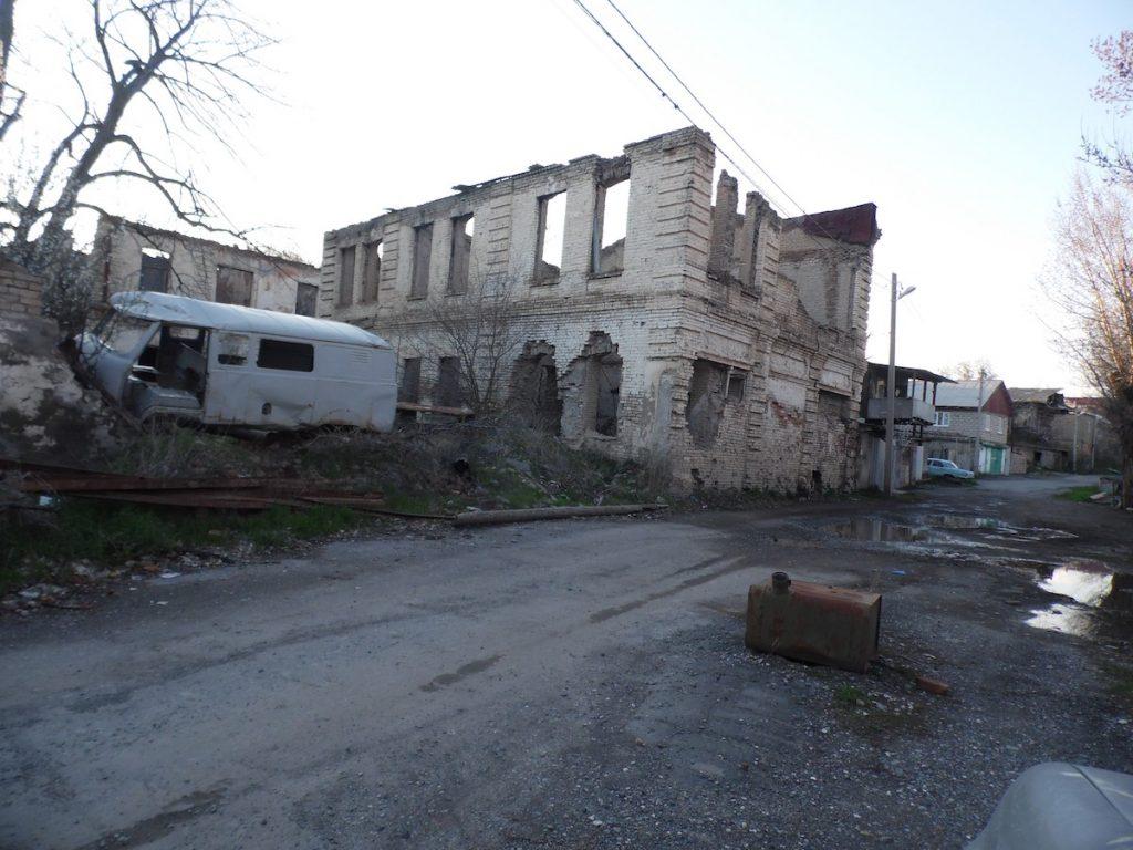 The destroyed building of a psychiatric hospital in Tskhinvali. Photo: Alan Parastaev, JAMnews